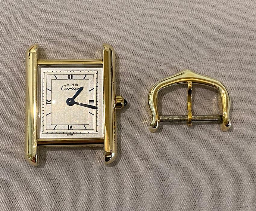 カルティエ時計修理後の表面とパーツ