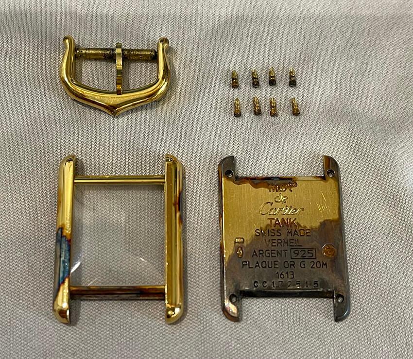 カルティエ時計修理前の枠と裏面とネジとパーツ