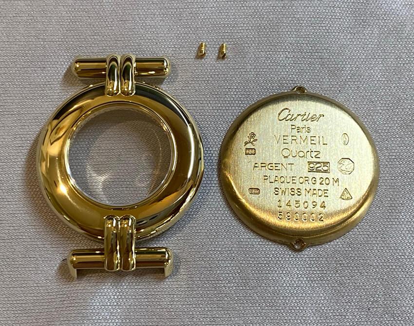 カルティエ時計修理後の枠と裏蓋とネジ